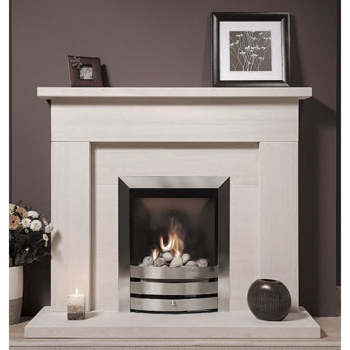 The Sherbourne Portuguese Limestone Fireplace is a popular suite in solid limestone with natural fossilisation unique to portuguese stone.jpg